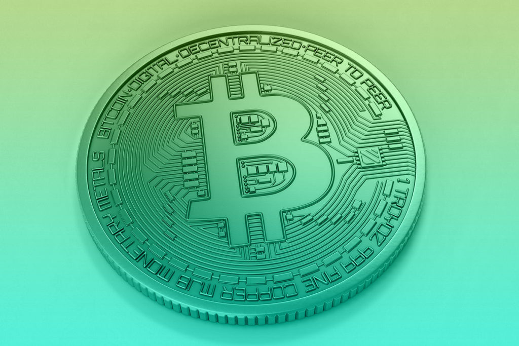 Stylized blue 'bitcoin' graphic, captioned 'Bitcoin Interest Rates Compared'